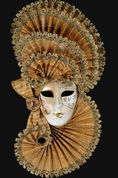 Mirandolina authentic venetian mask in papier mache. Handcrafted according to the original Venice carnival tradition. Manifactured in Venice by the famous venetian masters. Each item is provided with certificate of authenticity. Mask Dimensions Width: 32,5 cm Height: 62 cm Depth: