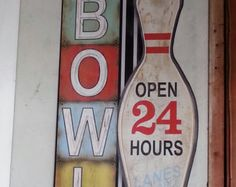 BOWL Open 24 Hours  Bowling alley metal sign with a vintage look.  28x16 inches Perfect for game room or den.