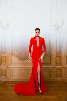 Stephane Rolland | Fall 2014 Couture | 33 Red long sleeve maxi dress with gold cuffs and deep V-neck (front)