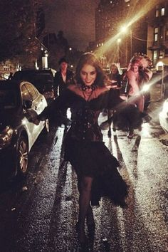Vanessa Hudgens looks menacing as a vampire in the streets.