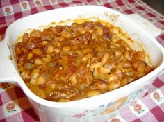 Baked Beans..used ground pork instead of bacon...added celery, onion, and green bell pepper...used tomato sauce instead of ketchup...used dried navy beans