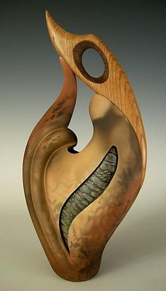 Terrific piece - Ceramic Sculpture in combination with wood, created by Jan Jacque - matte earth tones are pit fired in contrast to the glazed river bottom rock texture. Cherry wood flows from the clay to a graceful perch. The textured negative slope of the cherry is hand rubbed with copper.