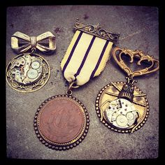 Vintage medals and clockwork pins - upcycled antiques - by Compass Rose Design   http://www.compassrosedesignjewelry.com/