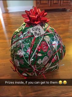 Our Christmas Game this year, filled with Prizes with the special gift in the Center. Consist of Packing Tape, Saran Wrap, Gift wrap, plastic grocery bags and funny notes inside, topped with a bow and string ribbon tied all around the outside. May the odds be in your favor!
