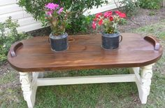This is an adorable coffee table that has a lightly distressed cream base and dark walnut stained top.