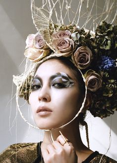 Hair by Chinatsu Nobe and head pieces by Graham Gabor.