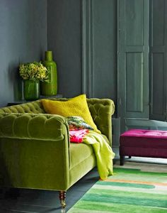 French Style. Green Velvet Chesterfield Sofa.  Moody Gray Walls.  Ruby Ottoman.  Delicious Colors.