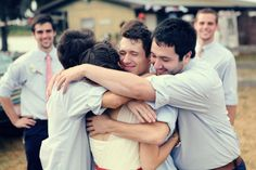 Photography by sarahashleypeters.com  Groomsmen hugging the bride. Cute shot.