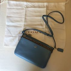 "NWT Coach Blue Leather Crossbody w/ Wallet  NWT (new with tags, retail, never been used) 100% authentic Coach blue leather crossbody with removable canvas wallet piece  and dustbag! Dimensions without the straps: 10.5"" X 7.3"" X 1.3"". Dimensions of the canvas removable wallet: 9.5 X 4.8 X .3"". Originally $225, this was marked down to $204.99. Will be selling lower than retail!!!  If you have any other questions, don't hesitate to ask! I will consider all reasonable offers! ☺️ Coach Bags…"
