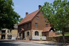 Old Salem settled by Moravians in 1750s in the historic district of Winston Salem has a living history museum where interpreters demonstrate early life in NC - blacksmith, apothecary and other trades