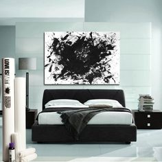DIY idea. The Love Is Art kit comes with a white canvas and black paint so couples can create a one-of-a-kind wall poster.
