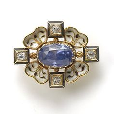 A Neo-Renaissance Sapphire, Diamond and Enamel Brooch by Phillips of Cockspur Street. English, c1890.