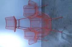 Vintage outdoor chairs Russell Woodard circa 1950's-60's, powder coated in fresh coral color.