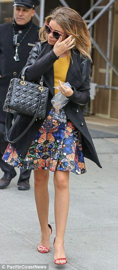Park Avenue princess: The Modern Family star kicked off her day in a preppy but different ensemble featuring a yellow T-shirt, a black leather and wool blazer and  a flared knee length patterned skirt