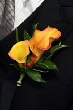 wedding lily boutonniere | And here, two calla lilies with ruscus leaves....need in orange and red or pink