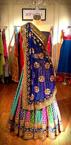 Multicoloured Lehenga with Purple Choli and Blue dupatta... Could use Magenta Dupatta too
