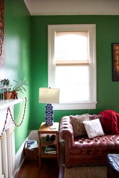 acrylics & icing: Bold green boho living room in New Orleans, Chesterfield sofa, mantle
