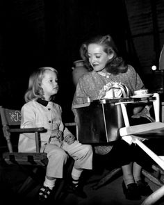 Bette Davis and Her Daughter...Davis Looks Proud of Her Young Daughter On Set, But Later Years Would See Much Trouble Come to this Relationship...Sadly, This Davis Would Die With Caregivers and Her Daughter Would Betray Her Famous Mom's Memory In A Tell-All Memior...But, Here, Bette Look Very Much A Proud Mom...
