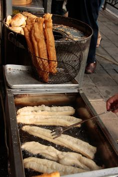 Yóu tiáo 油条 are deep-fried twists of bread, salted and crisp. They are almost exclusively a breakfast food, like jian bing, and are usually eaten with congee (zhōu) or with a bowl of steaming sweetened soy milk.  China.