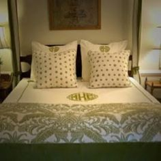 Monograms, mixed prints on a 4-poster bed. Love!