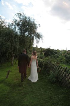 Marrid couple walking through the gardens at Kent Life