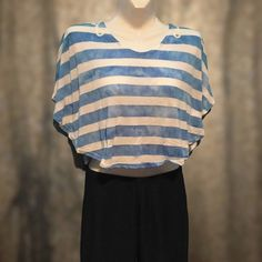 🔆Amazing striped crop top Loose fitting crop top. Laying flat it is shoes like a half circle. There is stitching where the arms go. So it kind of drapes over the shoulders. Very pretty lace detail on the back. I ❤️ Energie Tops Crop Tops