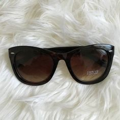 Oversized Tortoise Shell Rayban Wayfarer Knockoffs Oversized tortoise shell Rayban wayfarer knockoffs with silver side detail. Accessories Sunglasses