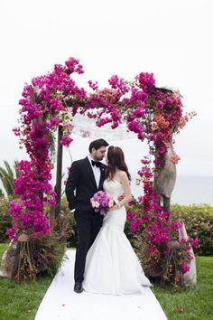 dark pink flowers wedding arch alter ideas / http://www.deerpearlflowers.com/fuchsia-hot-pink-wedding-color-ideas/