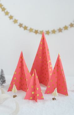 Learn how to make these simple and colorful paper Christmas trees using your favorite wrapping paper!