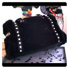 "**Reduced** Faux Fur Satchel in Black So soft, you cannot help but hug it! Rhinestone trim, Zipper top closure, rear zipper pocket, inside lining with open/zip, 15"" handles, 47"" adjustable strap. 12"" W x 7"" D x 8"" H Bags Satchels"