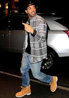 Drake... Oooh if there's anybody who could wear Timbs, flannel and a snapback...it would be him!