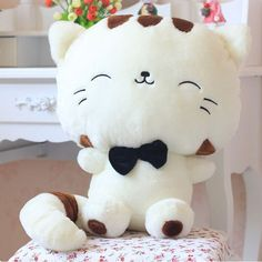 WHAT'S IN THE BOX 1 happy cat stuffed toy. DESIGN Available in white and yellow. Made of soft fabric and polypropene cotton. SIZE Height: 45cm Please Allow 3-4 Weeks for Delivery