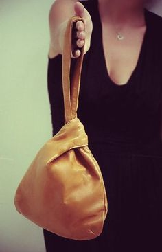 Hand holding leather pouch