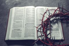Bible with a crown of thorns. ( Christianity Concept ).