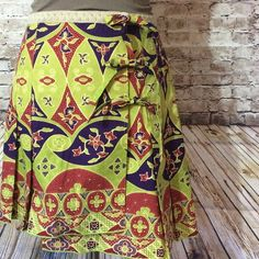 """✅bogo sale ✅Anna Sui for anthropologie New with tags !! This """"three's a charm"""" skirt is an asymmetrical wrap skirt with three ties in the front for a it of flair . 17"""" long on the shortest side of the skirt. Anthropologie Skirts Asymmetrical"""