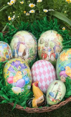 Paper Mache Easter Egg Containers from Germany.  Available in a range of sizes and designs, these old fashioned Easter decorations are perfect for candies and other small treats.