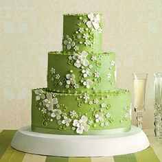 Vibrant Green Wedding Cake | Turn up the volume on a classic Southern flower—the spring-blossoming dogwood—by pairing it with icing in a vibrant shade of grass green. Jan Moon of Dreamcakes designed this cake with another twist: oval layers, instead of traditional round ones. | SouthernLiving.com