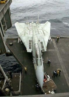 Raising a F-14 Tomcat on elevator 3 to the flight deck