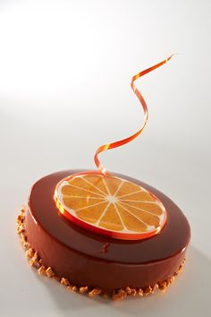 use thinly slice candied oranges to decorate the top of a cake perhaps even a wedding cake in a variety of citrus?