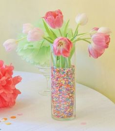 """101 Easy-to-Make Baby Shower Centerpieces sprinkle centerpiece idea…doesn't need to be tulips. """"sprinkles"""" can be plastic beads. Use mason jars if cheaper Diy Baby Shower Centerpieces, Diy Centerpieces, Easter Centerpiece, Baptism Centerpieces, Easter Decor, Sprinkle Shower, Sprinkle Party, Shower Bebe, Girl Shower"""