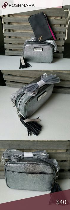 VS Crossbody Silver Bag & Black Makeup bag BUNDLE New with tags!  Excellent conditions!  Smoke free home!  *NO trades.  *Same or next day shipping.  A FREE VICTORIA'S SECRET GIFT WITH PURCHASE! (lip gloss or hair tie) Victoria's Secret Bags Crossbody Bags