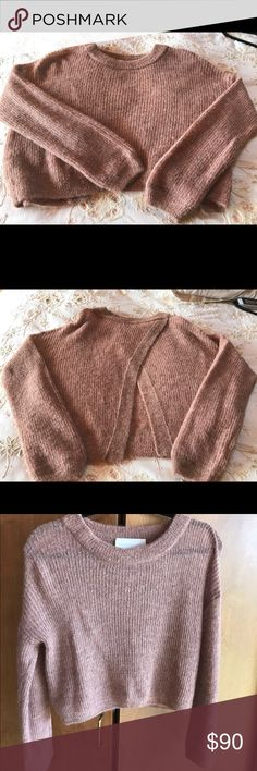 Michelle Mason cropped back crossover sweater Michelle Mason Back Cross blush/nude sweater,  back is crop cross and can open up for sexy summer look with white pants or jeans. This sweater is SO soft literally, but it's just sitting in my closet and it's time to move to a new closet where it is loved. Is NWT size XS. It's an all weather sweater The color is almost irredentist in light the thread they used. This is not a tight woven sweater which makes it perfect for layering in fall and…