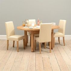 Light Oak 120-160cm Table and 4 Cream Quality wooden furniture at great low prices from PineSolutions.co.uk. Get Free Delivery and Exchanges on all orders. http://www.MightGet.com/january-2017-11/light-oak-120-160cm-table-and-4-cream.asp