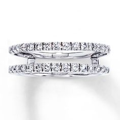 Rows of brilliant round diamonds wrap above and below your solitaire ring (sold separately) in this elegant enhancer ring. Crafted of 14K white gold, the ring has a total diamond weight of 1/2 carat. Diamond Total Carat Weight may range from .45 - .57 carats.