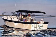 """This Luhrs Alura 30 """"Lyric"""" has been well maintained and meticulous cared for. This is by far one of the nicest and most well cared for Luhrs Aluras that I have seen. The boat shows like a much newer vessel. Low hours of 704 on the 270HP engine with a compression test completed 11-2015 at the time that the manifolds and risers were replaced. Recent updated include: New Sunbrella convertable top with enclosure and cockpit bimini with sun shades, New port hatches replaced including new…"""