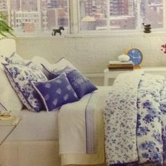 Blue and white bedrooms look so fresh.