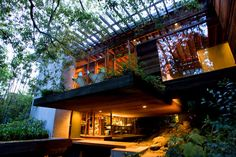 Architect Ray Kappe's home. Natural wood, lots of glass, privacy provided by the thick growth of oak trees, bamboo and eucalyptus outside.