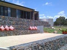 landscape design slope drainage with gabion | ... architectural rock gabion feature and retaining walls are the answer
