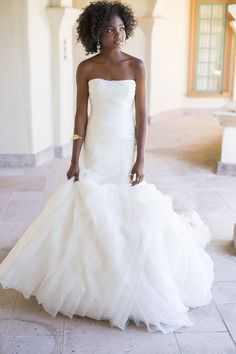 e4c6913f511 The dramatic skirt of this White by Vera Wang trumpet wedding dress is  handcrafted with over 70 yards of bias-cut organza tiers. White by Vera
