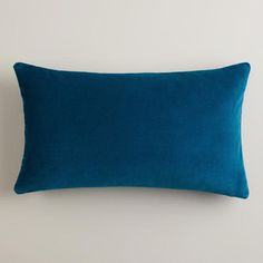 One of my favorite discoveries at WorldMarket.com: Night Blue Velvet Lumbar Pillow $10  Stack this pillow in front of the Ikat pillow
